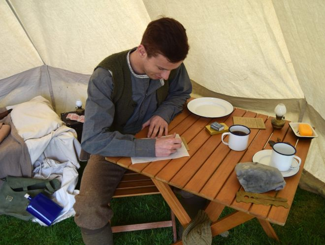 Robert in his tent resting behind the lines. Photo (c) John Bennett